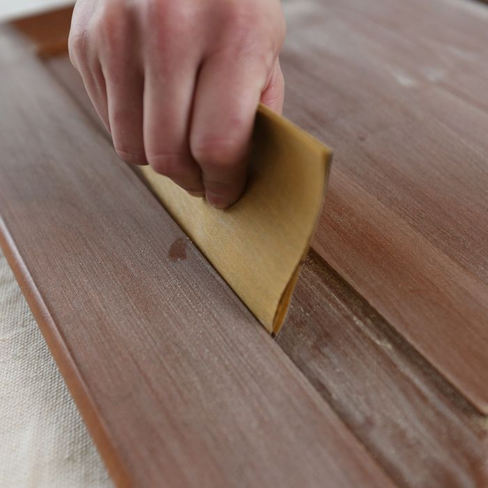 Sanding hard-to-reach areas by folding up a piece of sandpaper into a small square